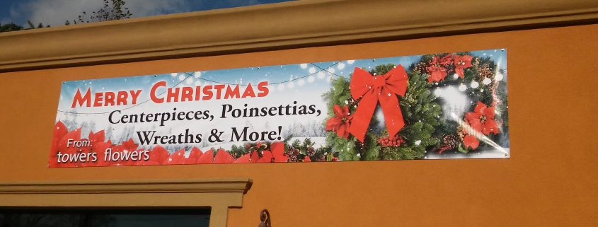 Holiday banner for retail flower shop on Higbie Lane in West Islip, NY
