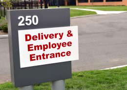 Entrance sign for Delivery and Employees