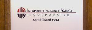 Door sign for insurance agency in Huntington, NY