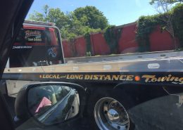 Tow truck lettering is visible on the Long Island Expressway every day