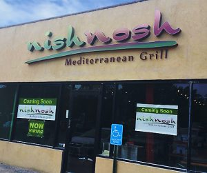 Channel lettering and temporary signs for restaurant