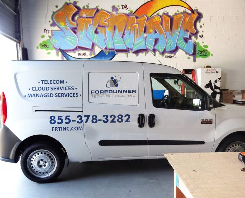 Vinyl lettering and logo on van in Signwave workshop