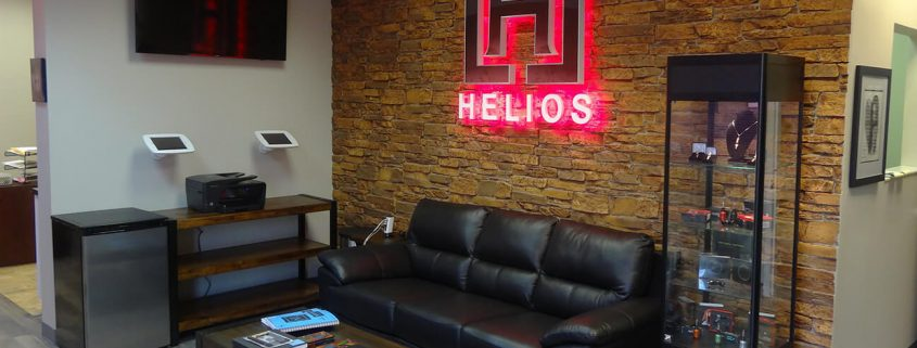 PVC sign with red LEDs casts a halo effect on the wall.