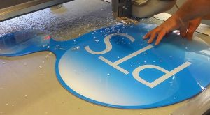Finishing edge of acrylic office sign