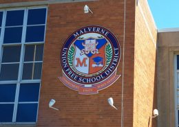 Medallion sign on building face