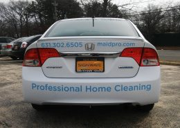 Vinyl lettering on back of Maidpro fleet