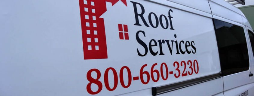 Roof Services van with vinyl logo and lettering