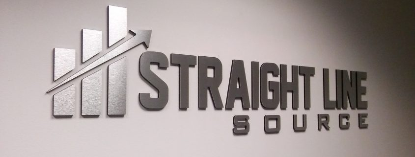 Reception area signs, logo sign, brushed aluminum letters