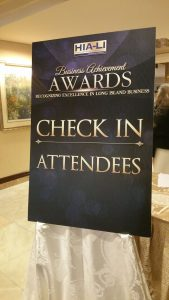 Poster directs event attendees to check in.