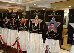 Posters highlighting Business Achievement Award winners