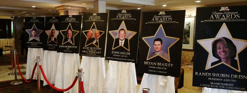 Posters highlighting Business Achievement Award winners