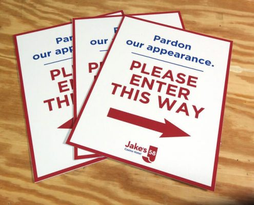 Temporary signs direct patrons to an alternate pathway during construction.