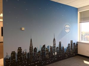 Cityscape wall mural with logo