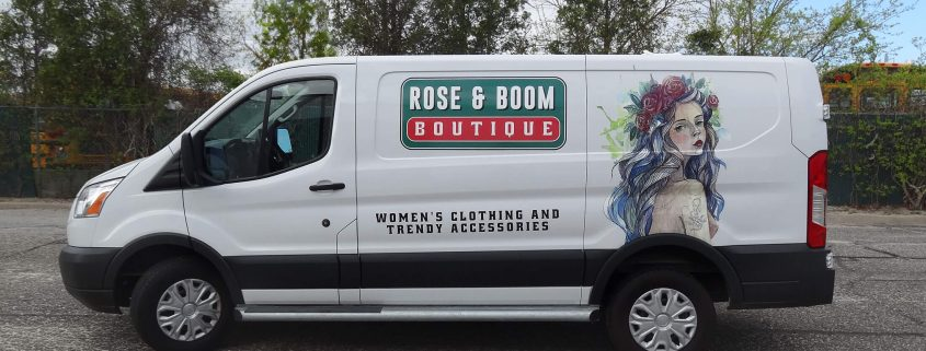 vinyl graphics and watercolor-style illustration are striking on the side of a white van.
