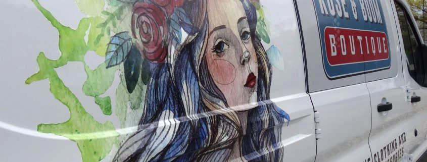 Close-up of watercolor-style illustration in vinyl on a white van.