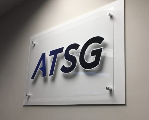 Mounted standoff sign in acrylic and PVC with vinyl for ATSG IT