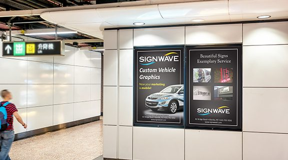 A photograph of SEG graphic ads in a subway
