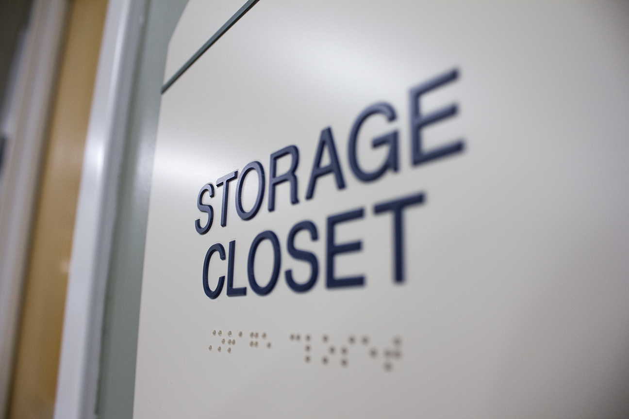 "ADA sign with raised lettering and Braille reading ""Storage Closet"""