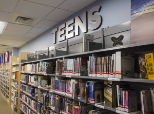 "Brushed aluminum letters mounted to wall reading ""TEENS"""