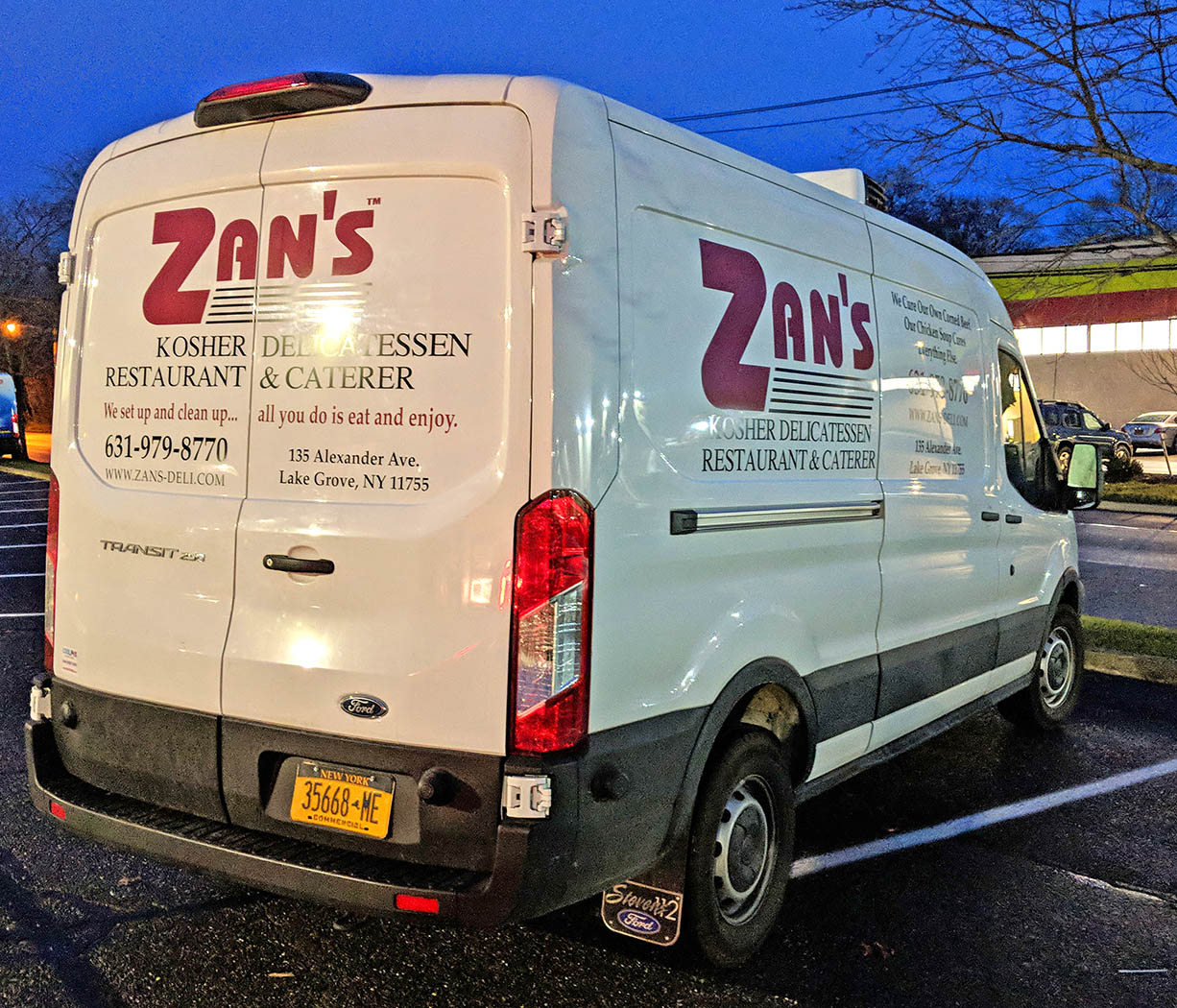 A white van with cut vinyl graphics for a catering company