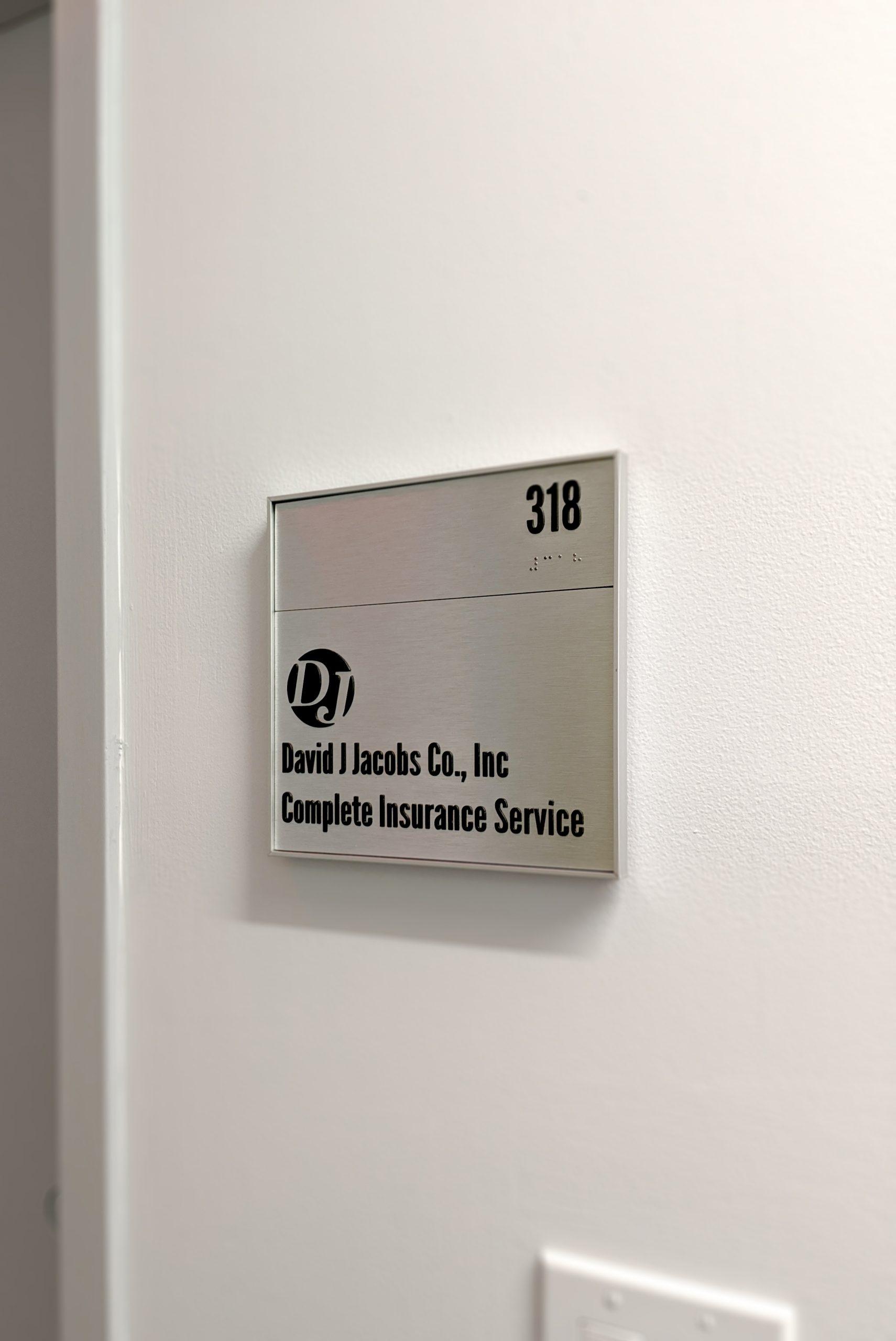 ADA interior tenant brushed aluminum signage