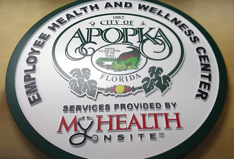 Sandblasted sign with printed vinyl graphic.