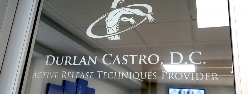 cut white vinyl logo and letters on glass door