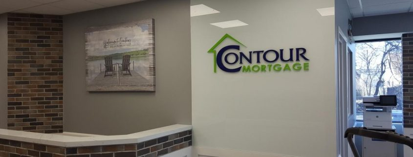 painted dimensional logo on glass wall